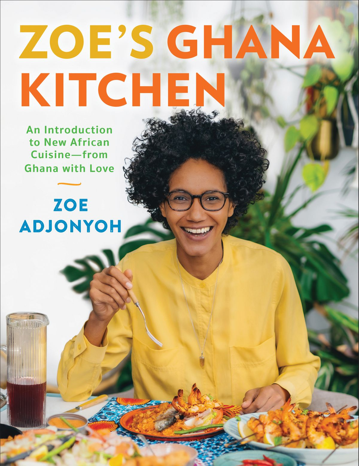 A cookbook cover with a woman wearing a yellow shirt and glasses