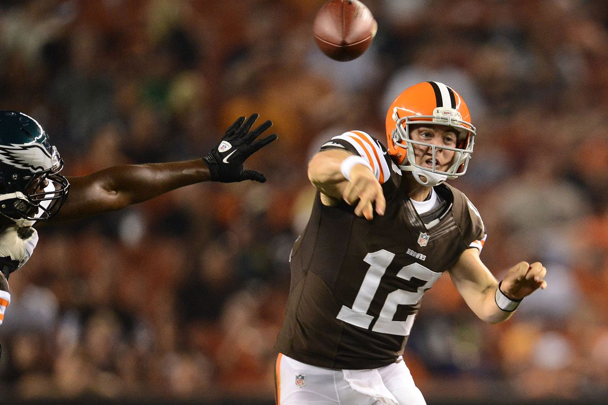 August 24, 2012; Cleveland, OH USA: Cleveland Browns quarterback Colt McCoy (12) throws a pass during the third quarter in a preseason game against the Philadelphia Eagles at Cleveland Browns Stadium.  Mandatory Credit: Eric P. Mull-USPRESSWIRE