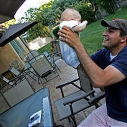 Spencer Zwick, 27, national finance director for Mitt Romney's presidential campaign, plays with his son Peter, 2 months, at his in-laws' home in Salt Lake City last month.
