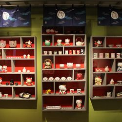 A glorious wall stacked with insanely adorable Hello Kitty goodies.