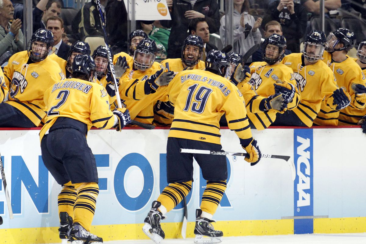 Quinnipiac forward Jordan Samuels-Thomas celebrates with his teammates on the bench after scoring a goal in the 2013 NCAA Semifinals against St. Cloud.