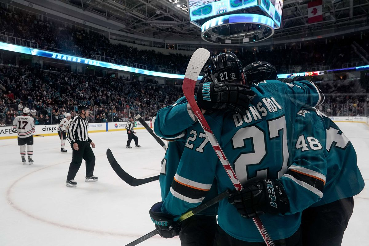 Mar 3, 2019; San Jose, CA, USA; San Jose Sharks right wing Joonas Donskoi (27) celebrates his goal with his teammates against the Chicago Blackhawks during the first period at SAP Center at San Jose.