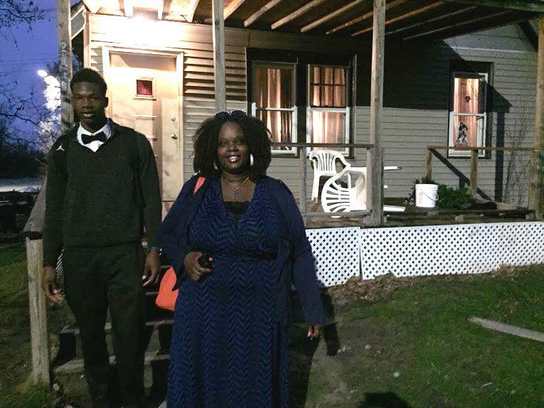 Myesha Williams heads out before dawn to drive son Elijah, 17, to school. Her three sons attend three different Detroit schools. (Photo by: Erin Einhorn/Chalkbeat Detroit)