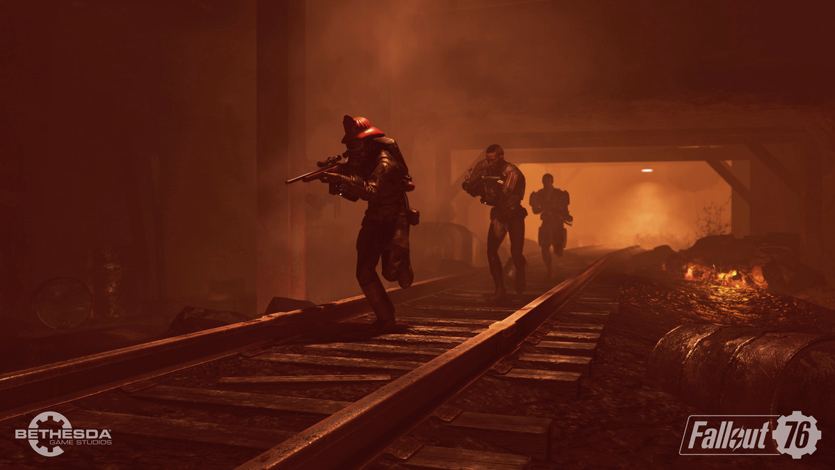 A team of four players move through a tunnel in Fallout 76