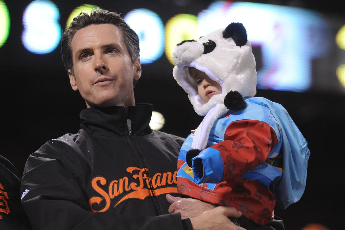 San Francisco mayor Gavin Newsom stands with his daughter Montana Newsom while watching the San Francisco Giants play the Philadelphia Phillies in Game 5 of the National League Championship Series on Thursday, Oct. 21, 2010, at AT&T Park in San Francisco,