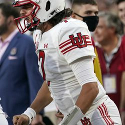 Utah quarterback Cameron Rising celebrates after throwing a touchdown pass to wide receiver Money Parks during the first half of an NCAA college football game against Southern California Saturday, Oct. 9, 2021, in Los Angeles.