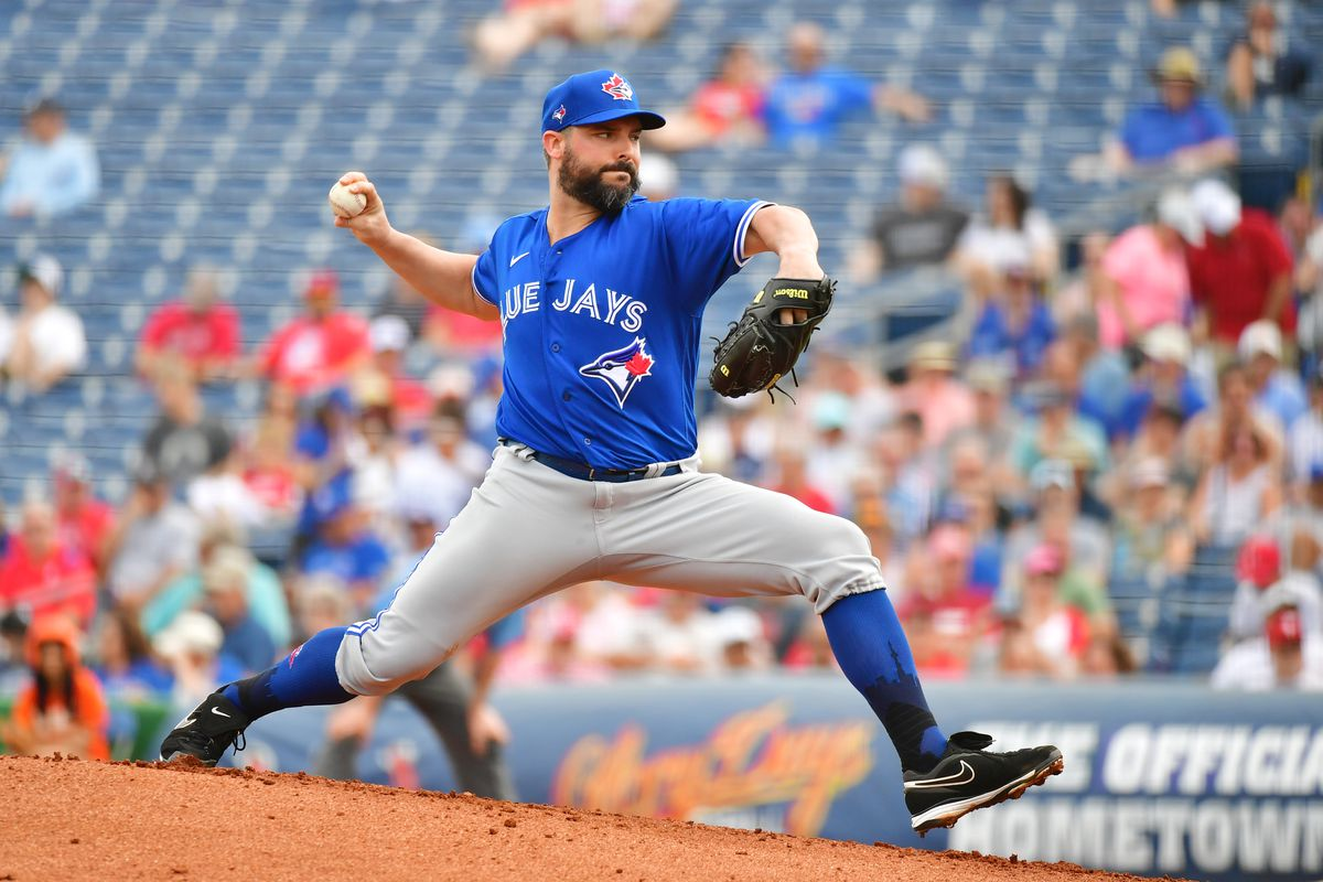 Tanner Roark #14 of the Toronto Blue Jays delivers a pitch during the first inning of a Grapefruit League spring training game against the Philadelphia Phillies