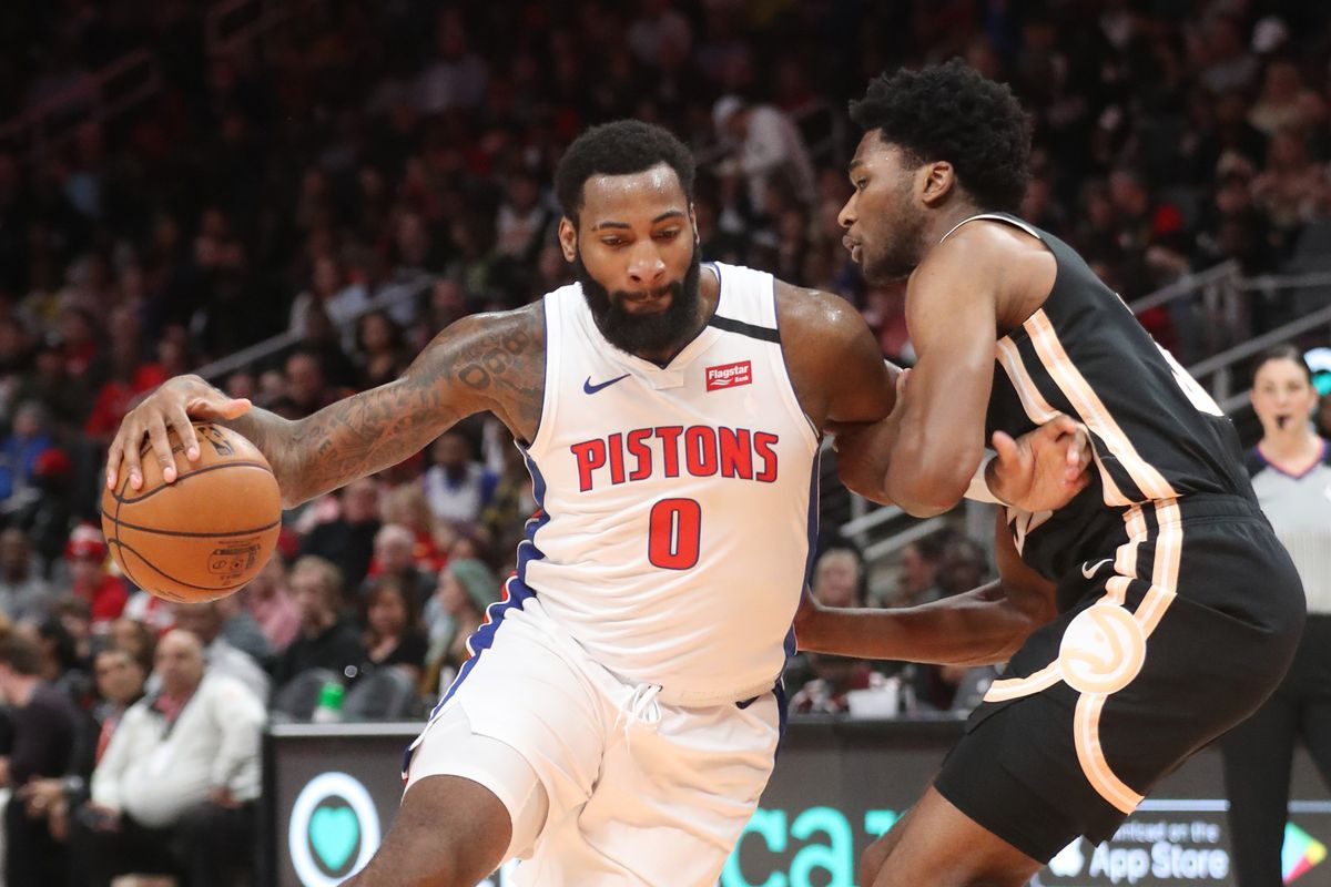 Detroit Pistons center Andre Drummond drives against Atlanta Hawks center Damian Jones in the first half at State Farm Arena.
