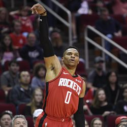 Houston Rockets guard Russell Westbrook reacts after making a three-point basket during the first half of an NBA basketball game against the Utah Jazz, Sunday, Feb. 9, 2020, in Houston.