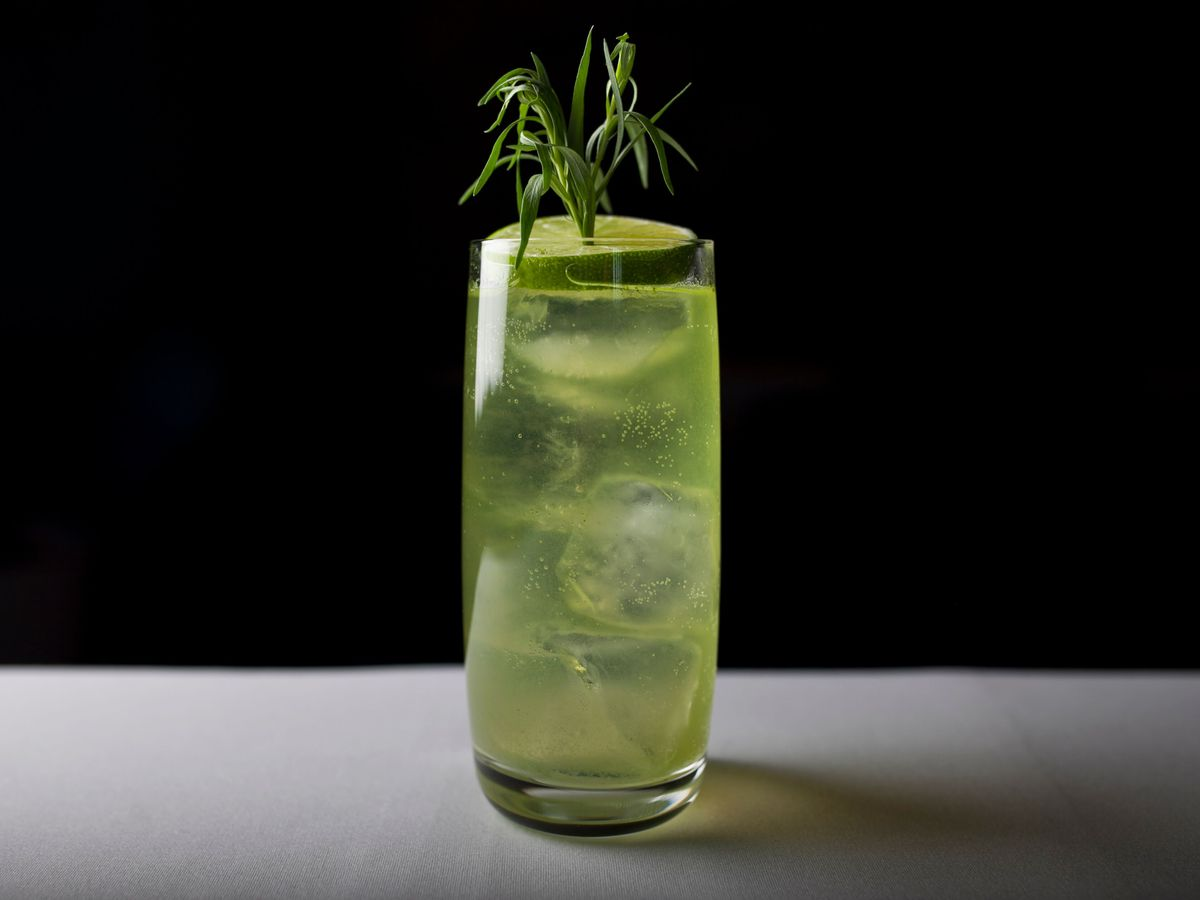 A green cocktail in a tall glass.