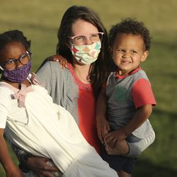 Tabitha Davis holds her children, Vivian and Donovan, during a fast, march and prayer vigil for racial injustice at the Capitol in Salt Lake City on Sunday, June 14, 2020.