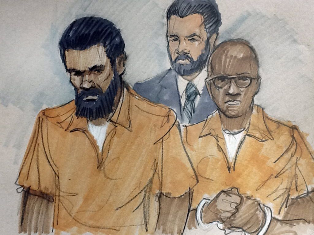 In this courtroom sketch, Jonas M. Edmonds, left, and Hasan R. Edmonds, right, stand in front of an FBI agent as they appear at a hearing at federal court in Chicago on March 26, 2015, following their arrests on charges of conspiring with the Islamic Stat
