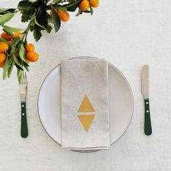 "Rachel Craven Flax Linen Napkin Set with Gold Diamond Print, $96 at <a href=""http://rachelcraventextiles.bigcartel.com/product/flax-linen-napkins-with-gold-leaf"">Rachel Craven</a>"