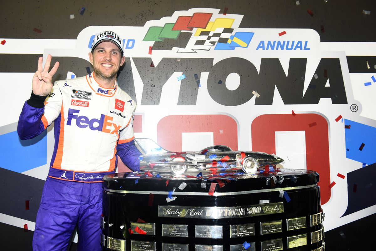Denny Hamlin, driver of the FedEx Express Toyota, poses with the trophy in Victory Lane after winning the NASCAR Cup Series 62nd Annual Daytona 500 at Daytona International Speedway on February 17, 2020 in Daytona Beach, Florida.