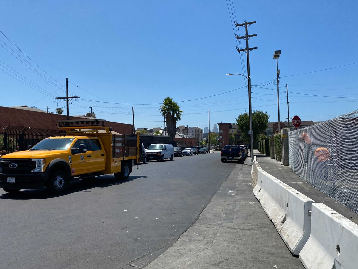 City workers put up fencing at the former Avenue 26 Night Market in Lincoln Heights.