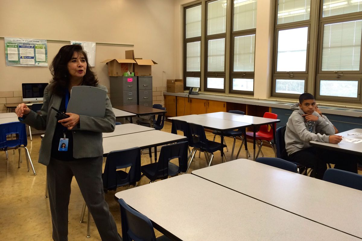 Kepner Middle School principal Elza Guajardo visits a classroom Sept. 12. The students were solving a murder mystery.