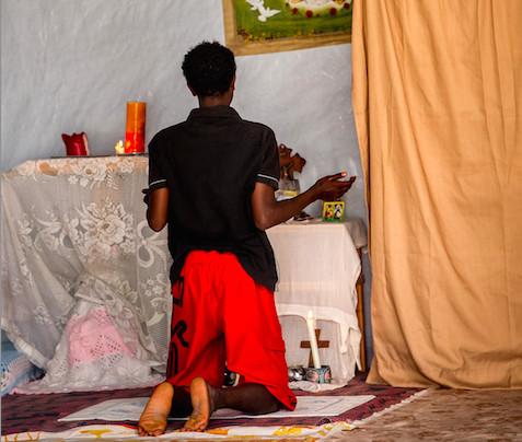 Calais migrant praying
