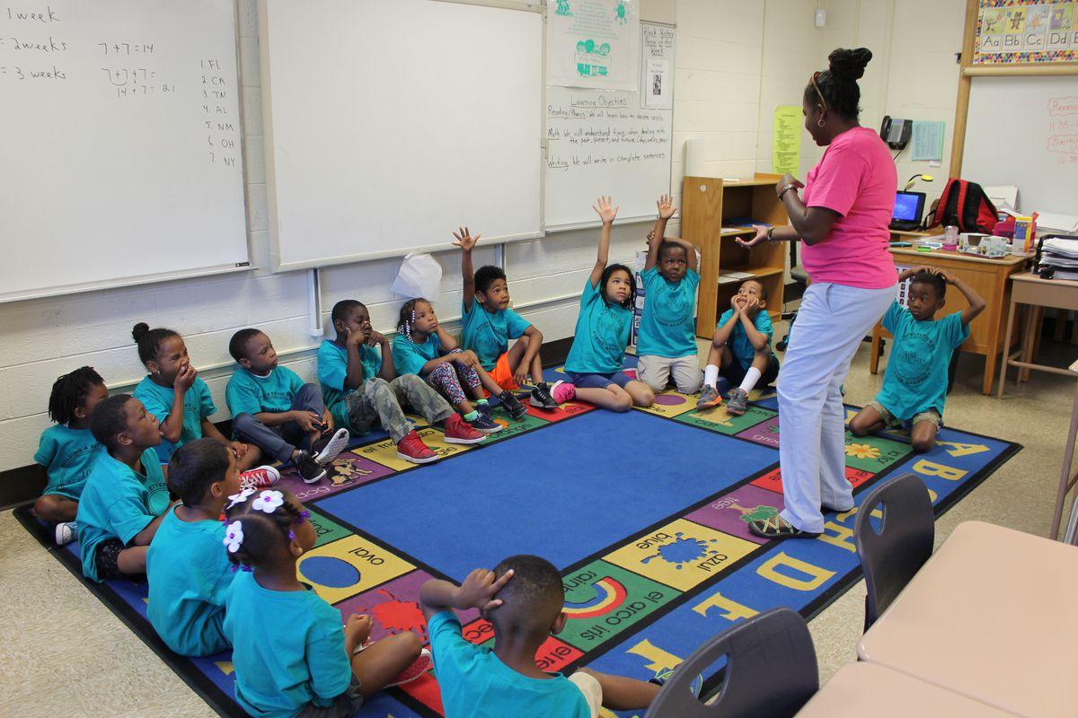 Kindergarten students participate in activities at the 100 Black Men Summer Academy at IPS School 74.