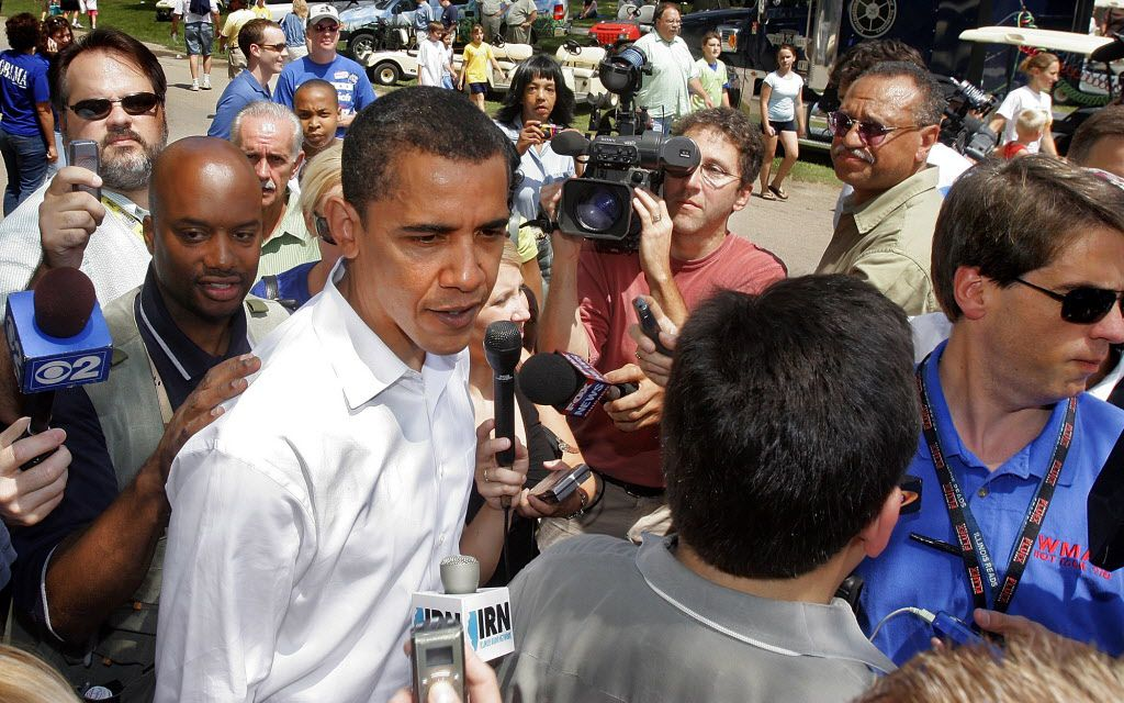 """U.S. Sen. Barack Obama is surrounded by reporters as he attends a """"Democrat Day"""" rally at the Illinois State Fair in Springfield, Ill., Wednesday, Aug. 16, 2006. (AP File Photo/Seth Perlman)"""