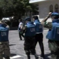 This image made from video made available by Syrian TV shows United Nations observers during a visit to Homs, Syria, Saturday, April 21, 2012. Five U.N. truce monitors ventured Saturday into the heart of the Syrian uprising, one of the hardest-hit opposition strongholds, and were thronged by residents clamoring for foreign military help to oust President Bashar Assad. Activists said Homs, which has been battered by tank and mortar shells fired by regime forces for weeks, was relatively calm during the visit, except for the sound of sporadic gunfire, and that troops pulled armored vehicles off the streets.