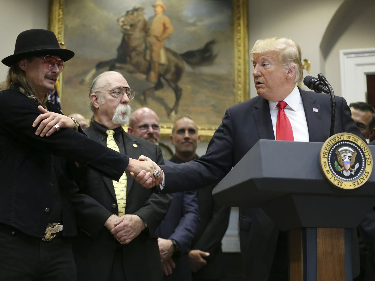 Donald Trump shares a handshake with Kid Rock prior to signing the Music Modernization Act on October 11, 2018.