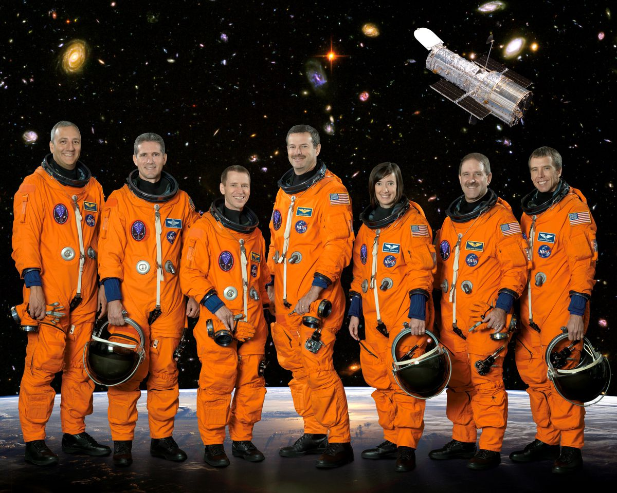 Grunsfeld (second from right) poses with the rest of the STS-125 crew before a 2009 servicing mission to the Hubble Space Telescope.