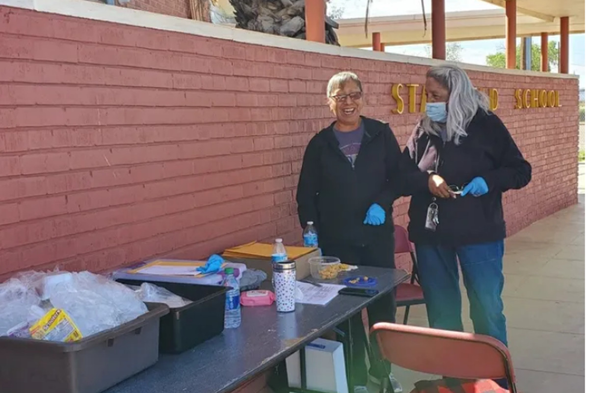Rose Gamez (left), a paraprofessional with the Stanfield school district, and kindergarten teacher Maria Garcia helped feed children in their Arizona district over the summer.