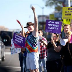 Same-sex marriage supporters rally on State Street in Salt Lake City on Tuesday, April 28, 2015.