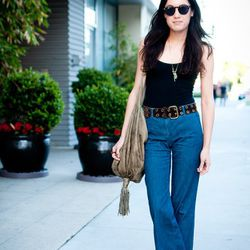"""<a href=""""http://la.racked.com/archives/2011/04/19/shawna_at_2nd_and_central_avenue.php"""" rel=""""nofollow"""">Shawna</a>'s bodysuit is from American Apparel, her shoes are from Madewell, and her jeans and bag are vintage."""