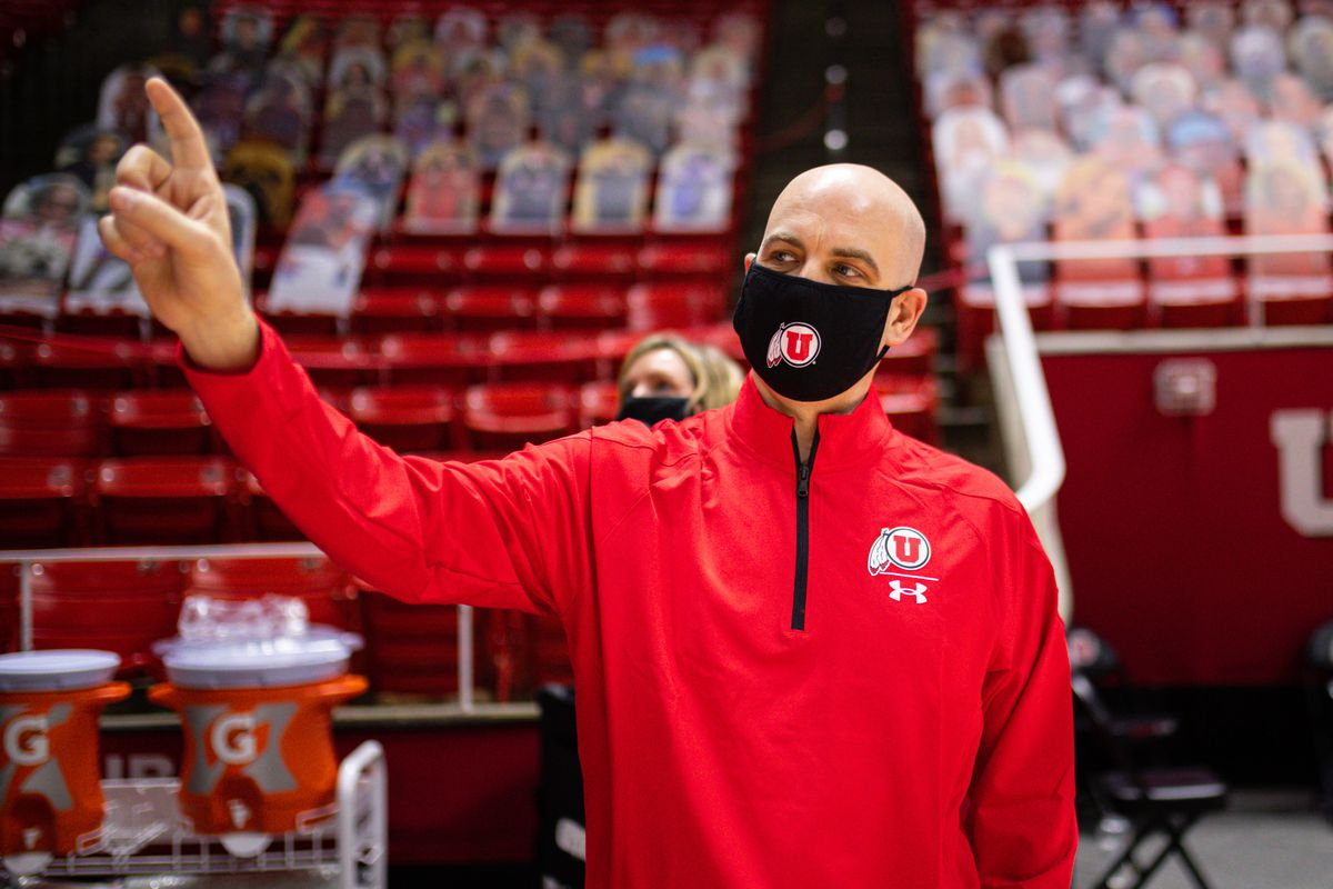 Utah Runnin' Utes basketball coach Craig Smith motions with his hand during tour of the team's basketball facilities.
