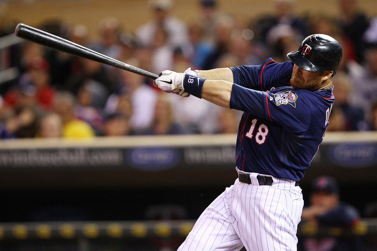 June 12, 2012; Minneapolis, MN, USA: Minnesota Twins designated hitter Ryan Doumit (18) hits a double in the eighth inning against the Philadelphia Phillies at Target Field. The Twins won 11-7. Mandatory Credit: Jesse Johnson-US PRESSWIRE