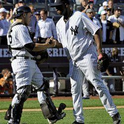 New York Yankees closer Rafael Soriano, right, celebrates with catcher Russell Martin after the Yankees defeated the Toronto Blue Jays 4-2 in the first baseball game of a doubleheader, Wednesday, Sept. 19, 2012, at Yankee Stadium in New York.