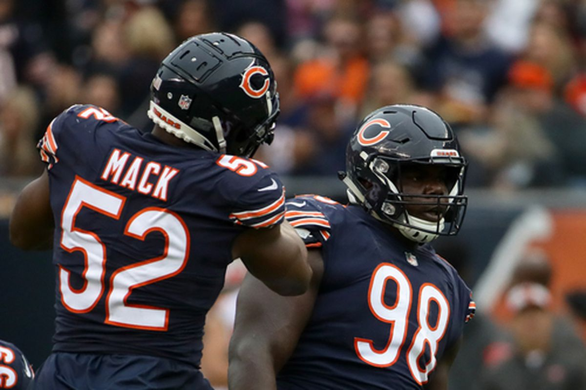 cd393d74015 CHICAGO, IL - SEPTEMBER 30: Khalil Mack #52 and Bilal Nichols #98 of the Chicago  Bears celebrate after making a tackled against the Tampa Bay Buccaneers in  ...