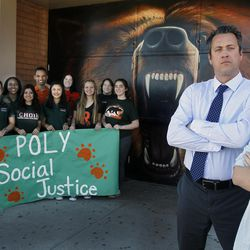 The Poly Social Justice Council, left, along with Principal Michael Roe and Ashley Gore, student and editor of the school newspaper, poses in front of the school's mascot at  Poly High School, on Feb. 16,  2016, in the city of Riverside.