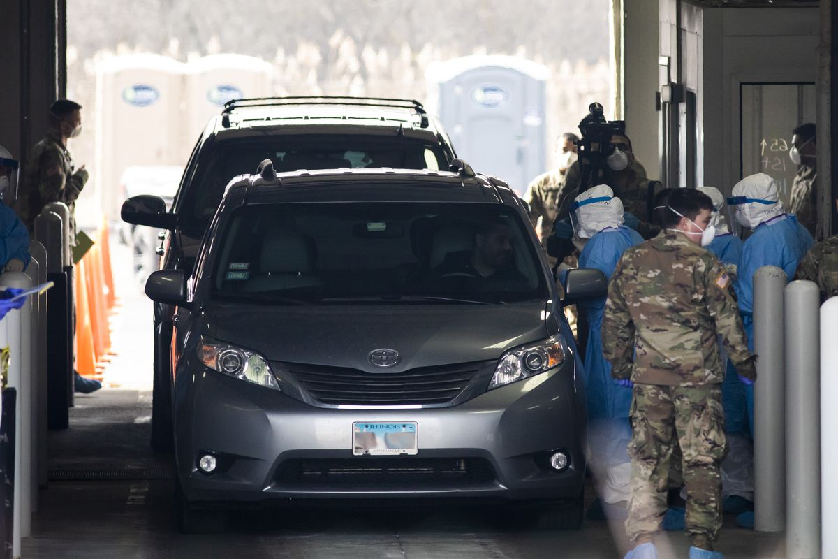 The Illinois National Guard operates a COVID-19 drive-thru test site for medical personnel and first responders on March 24, 2020.
