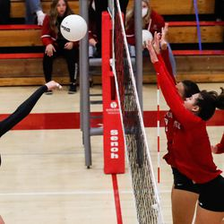 Lehi's Savannah Bedier (14) attempts to hit the ball against Bountiful players during a high school 5A volleyball quarterfinal at Bountiful High School in Bountiful on Thursday, Nov. 5, 2020.