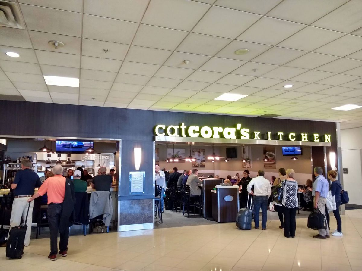 A line of people at the host stand at Cat Cora's Kitchen on Concourse A inside Atlanta's Hartsfield-Jackson International Airport
