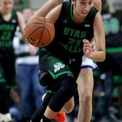 Utah Valley University Wolverines guard Gabrielle Leos (21) drives past Cal State Bakersfield Roadrunners guard Kate Tokuhara (30) in the 2017 WAC Tournament quarterfinals at Orleans Arena in Las Vegas on Wednesday, March 8, 2017.