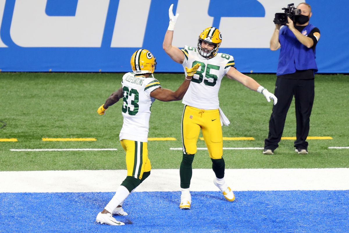 Green Bay Packers tight end Robert Tonyan (85) celebrates his touchdown with Green Bay Packers wide receiver Marquez Valdes-Scantling (83) during the second half of an NFL football game between the Green Bay Packers and the Detroit Lions in Detroit, Michigan USA, on Sunday, December 13, 2020.