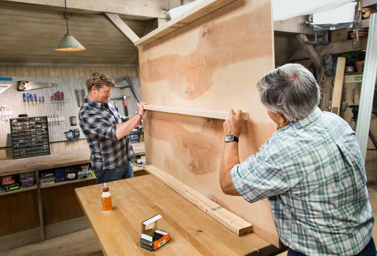 Tom Silva and Kevin O'Connor Gluing 2x4 Wood Panels On Back Of DIY Headboard