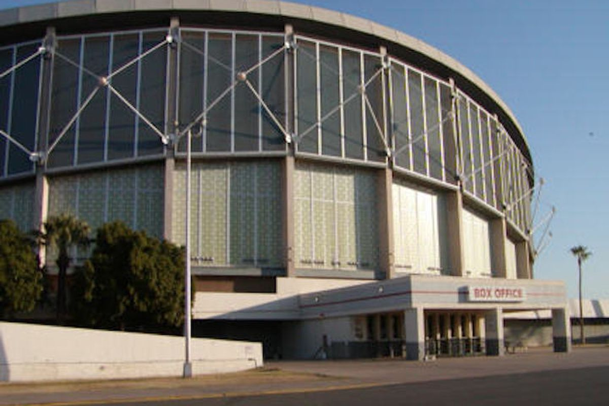 Exterior of round, steel-and-glass sports arena