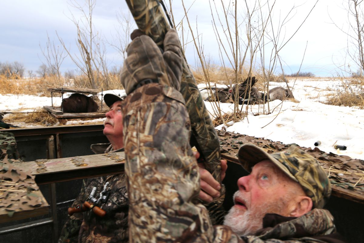 At age 90, retired Minnesota Vikings coach and noted outdoorsman Bud Grant targeted a drake mallard while hunting in Nebraska in January 2018 with longtime friend and retired Cabela's president and CEO Dennis Highby, left.
