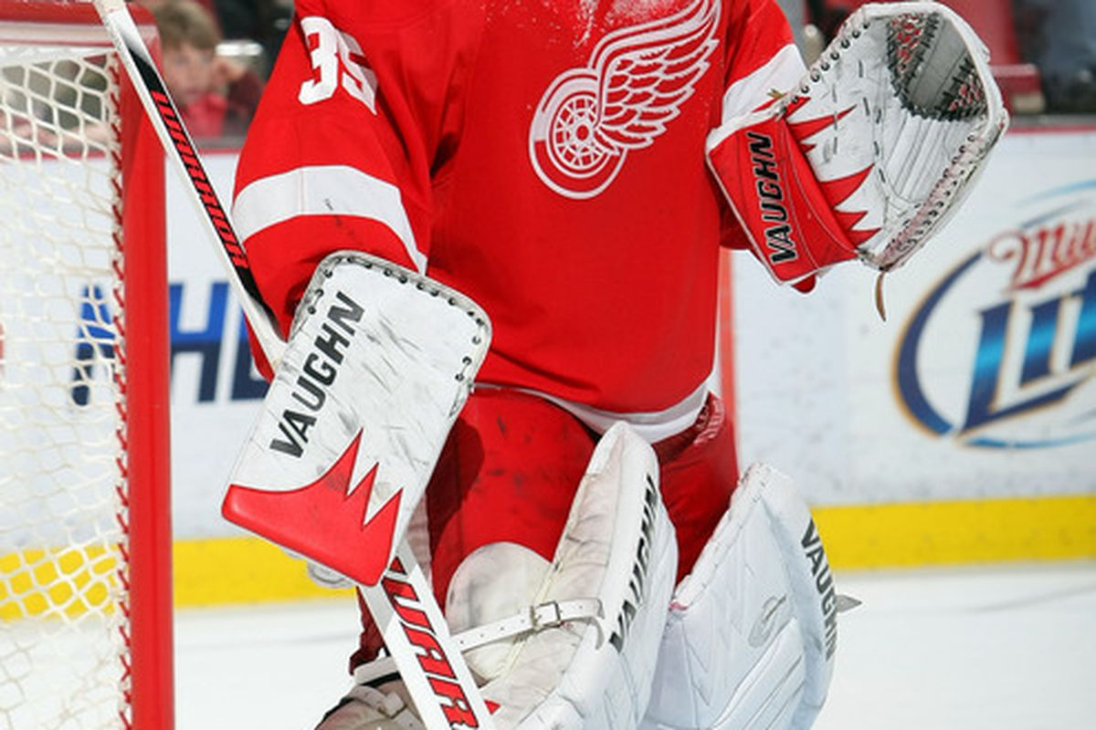 DETROIT - NOVEMBER 11:  Jimmy Howard #35 of the Detroit Red Wings keeps his eyes on the play against the Edmonton Oilers during their NHL game at Joe Louis Arena on November 11 2010 in Detroit Michigan.(Photo By Dave Sandford/Getty Images)