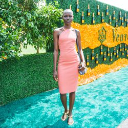 Grace Bol stunned in all-coral with gold accessories.