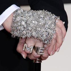 Madge's blingy hand and ring candy.