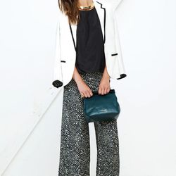The Addicted to Love blazer in white pairs well with the printed trousers.