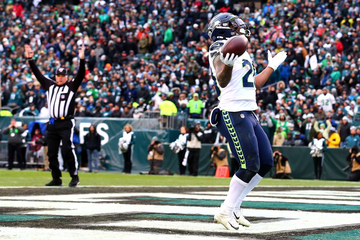 Rashaad Penny of the Seattle Seahawks celebrates after rushing for a fourth quarter touchdown against the Philadelphia Eagles at Lincoln Financial Field on November 24, 2019 in Philadelphia, Pennsylvania.