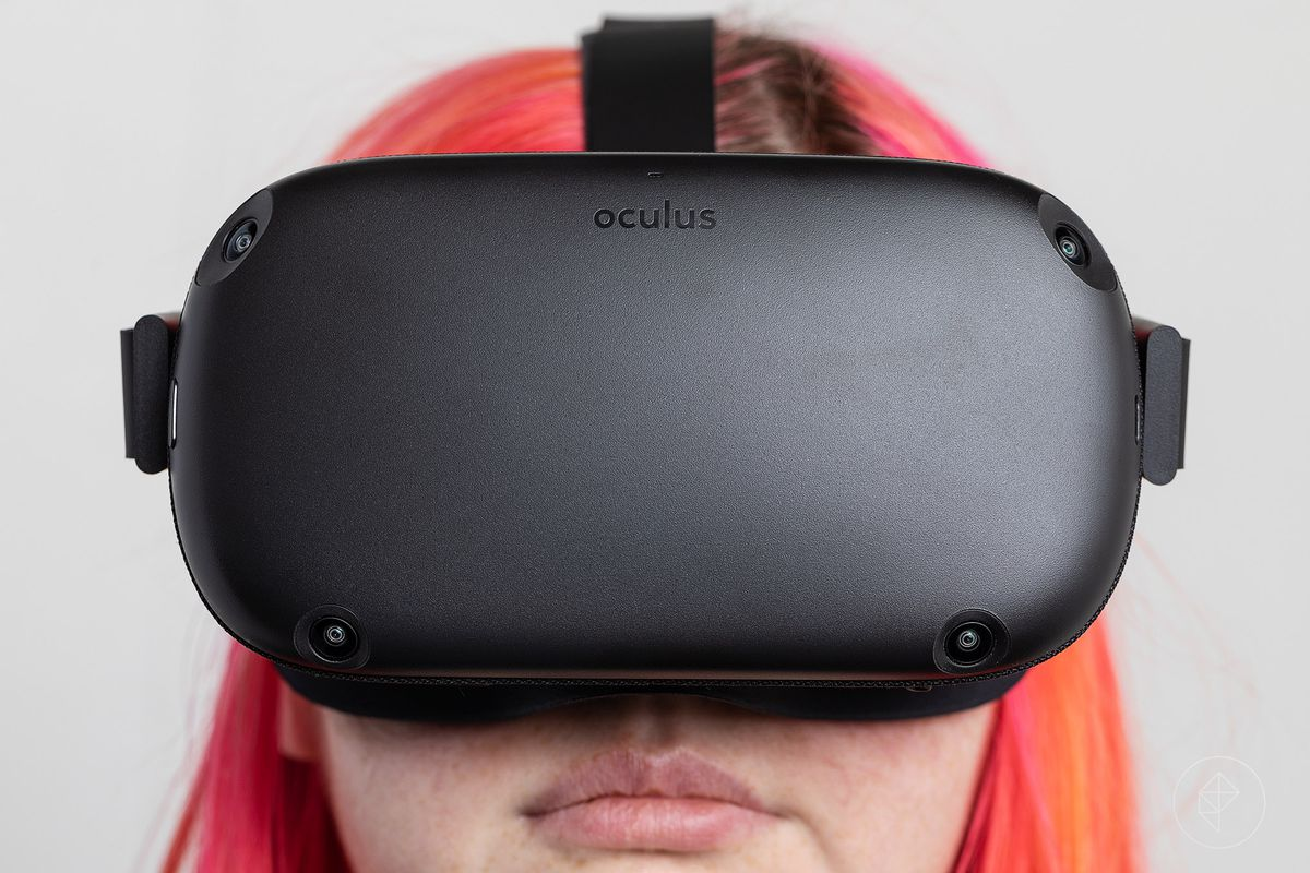 Close up of the Oculus Quest being worn by a woman with pink hair