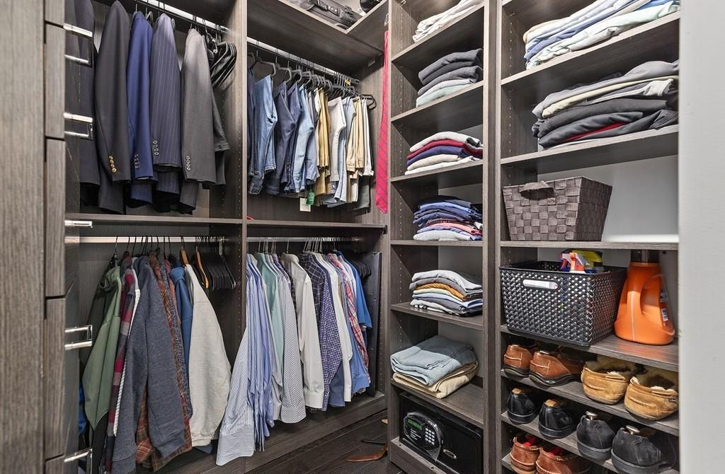 A small walk-in closet with shelving.