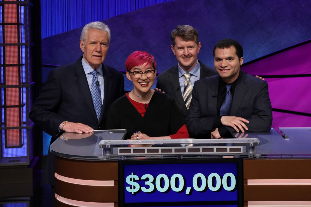 """Host Alex Trebek, left, with Team Ken, Monica Thieu, Ken Jennings and Matt Jackson, during the """"Jeopardy! All-Star Games"""" finale."""